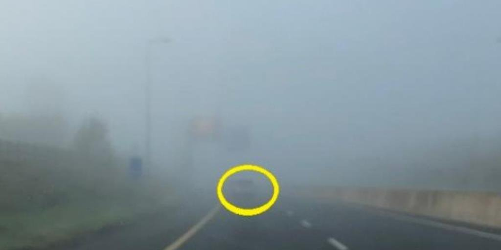 Spot the car driving on a motorway in heavy fog - no lights!